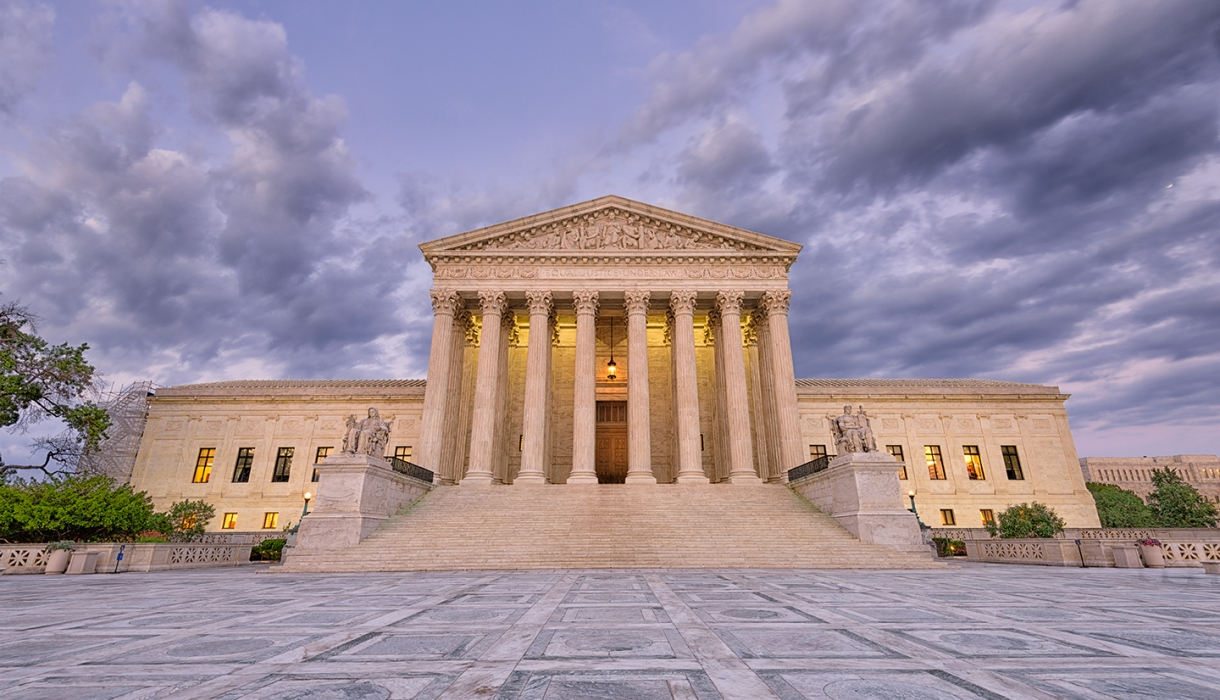 Photo of the U.S. Supreme Court Building at dusk