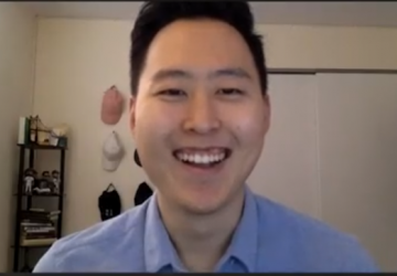 Justin Yun in front of his computer at home
