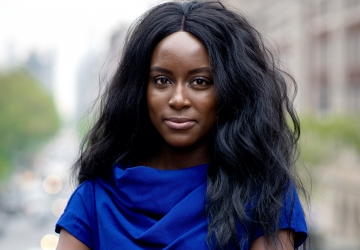Columbia Law Review Editor in Chief Oluwatumise Asebiomo in blue dress