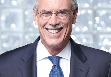 Former U.S Solicitor General Donald Verrilli Jr. in blue suit with a white shirt and blue tie/