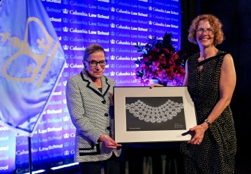 Dean Gillian Lester presents Ruth Bader Ginsburg with a custom made lace collar.