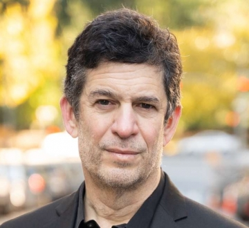 Columbia Law Professor Michael Heller in dark shirt and blazer