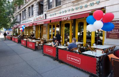 Tables outside the Le Monde Cafe on Broadway