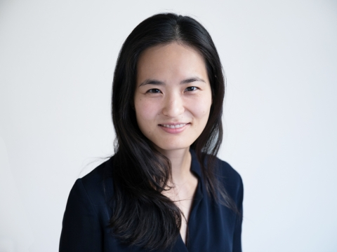 Portrait of Sarah Seo in black against a white background.