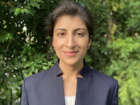 Columbia Law professor Lina Khan in blue jacket and white camisole