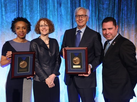 2019 Medal for Excellence honorees Nina Shaw and Jonathan Schiller hold up their medals with Dean Gillian Lester.