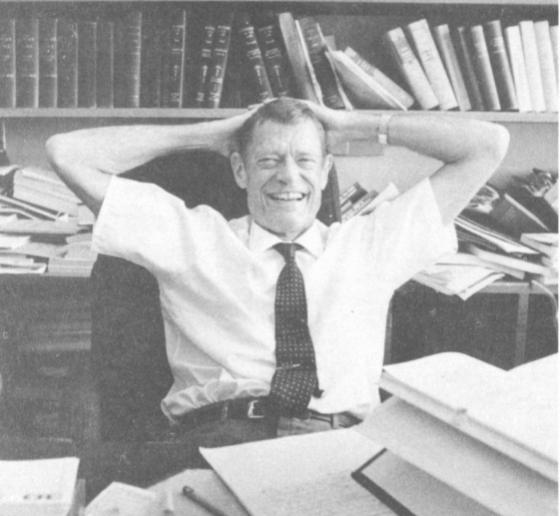 Archival black and white photo of Willis L.M. Reese sitting at a desk in front of a bookshelf.