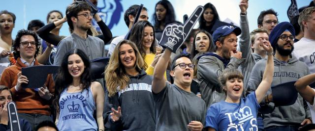 Students cheer at the Dean's Cup basketball game.
