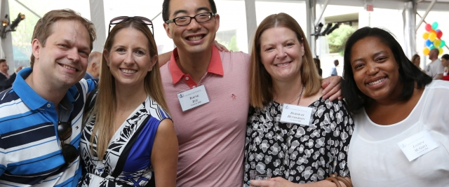 Five alumni smile in the tent at the family luncheon at Reunion 2016