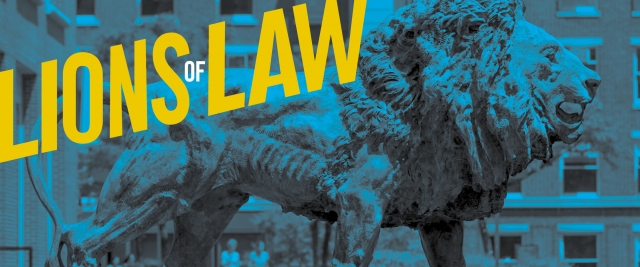 A statue of the Columbia lion emblazoned with the words Lions of Law in yellow letters