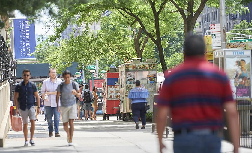 Food carts line the sidewalk on Broadway outside Columbia.