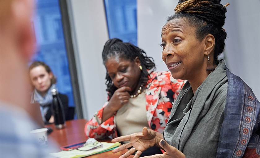 Professor Kimberlé Crenshaw teaching in a conference room.