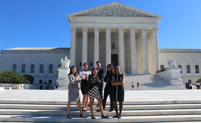 The Health Justice Advocacy Clinic students stand in front of the U.S. Supreme Court building..