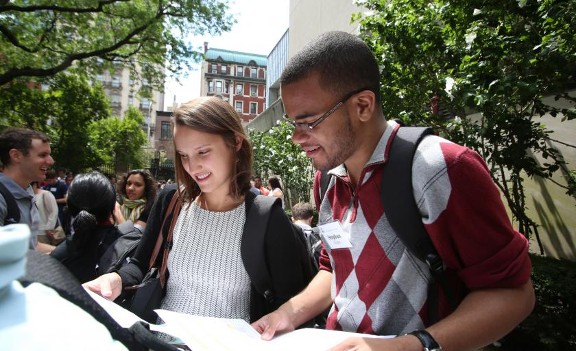 Two students look at lists outside the Law School.