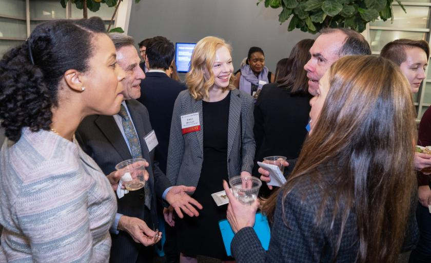 Students socialize with alumni and employers at the Public Interest/Public Service reception.