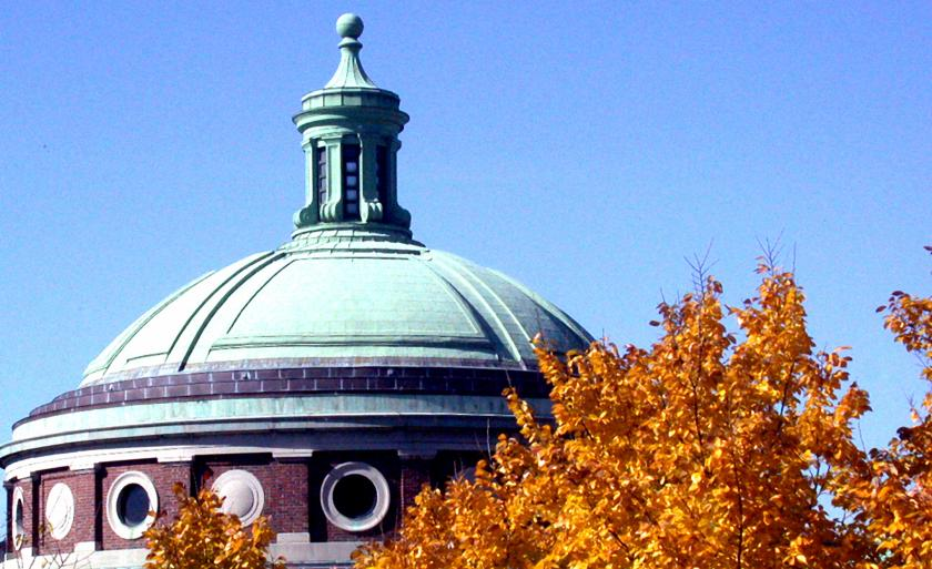 The dome of the Columbia University chapel by an orange tree