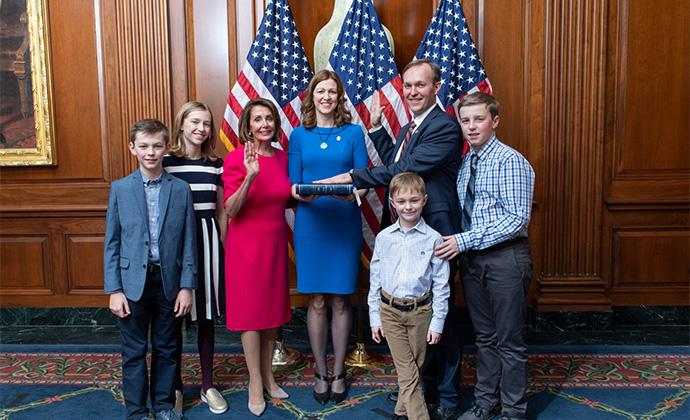 Ben McAdams and his family at his swearing-in with Nancy Pelosi. Courtesy official House photographer.