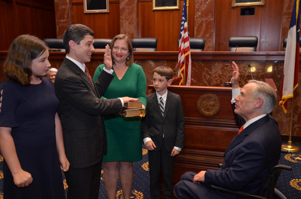 Brett Busby '98 being sworn into the Texas Supreme Court