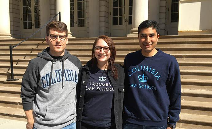 Alex Clavering '20, Julia Ghahramani '20, and Ankit Jain '19 on the steps of New York's City Hall before a March for Our Lives press conference.