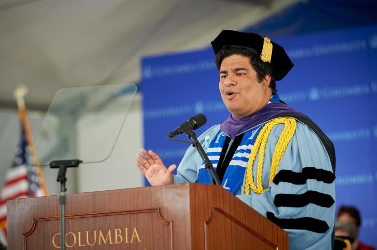Pablo E. Zevallos '19 speaks at a podium