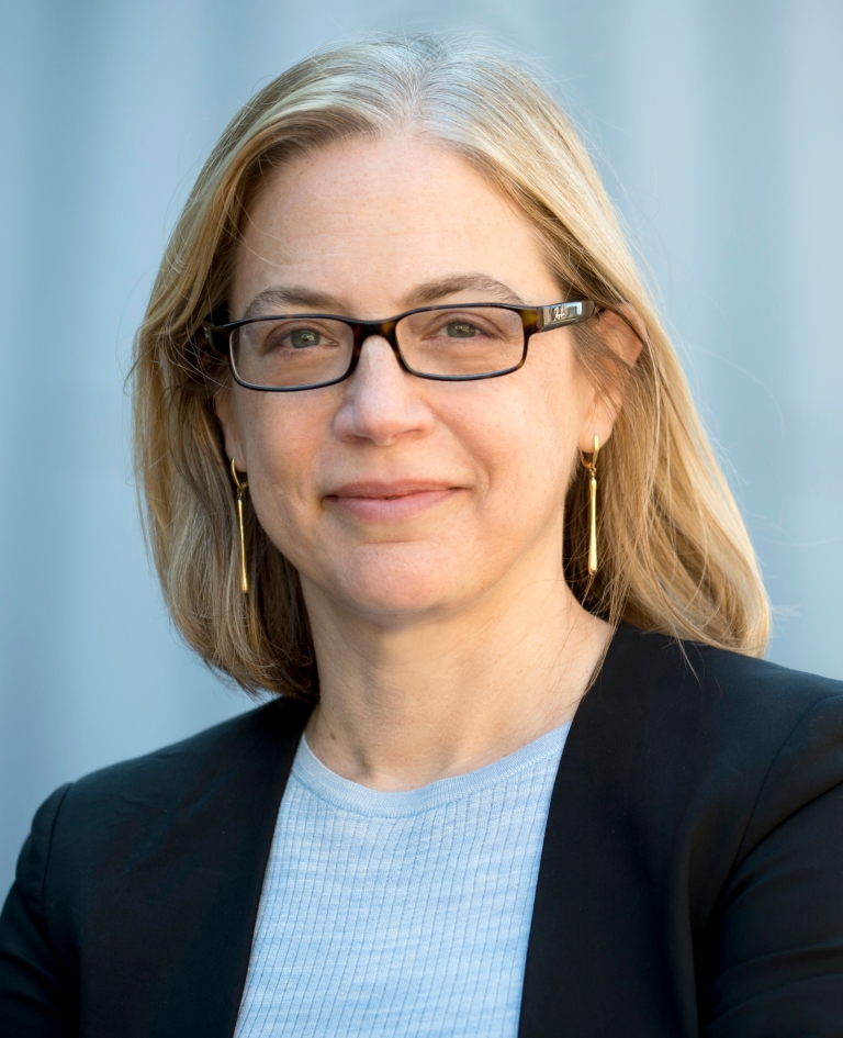 Columbia Law Professor Gillian Metzger in glasses and light blue sweater and dark blazer