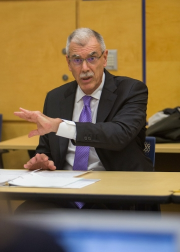 Donald B. Verrilli Jr. '83 in a suit and tie teaching in a classroom at Columbia Law School.